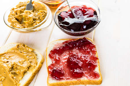indulgence: Homemade peanut butter and jelly sandwich on white bread.