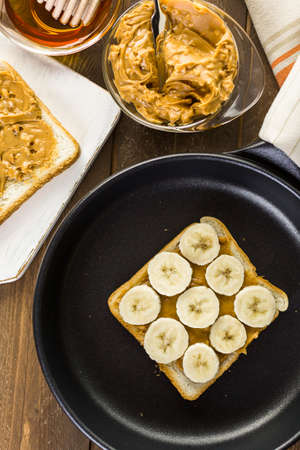 fryed: Homemade peanut butter and banana  sandwich on white bread.