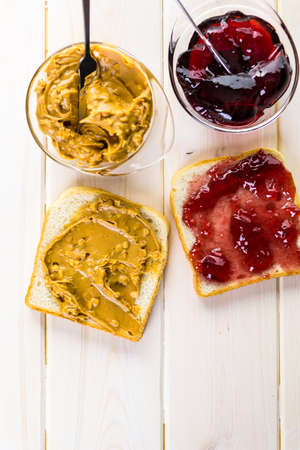 jelly sandwich: Homemade peanut butter and jelly sandwich on white bread.