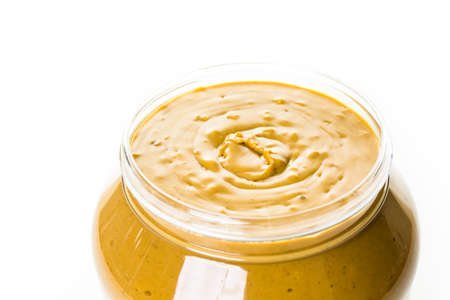 chunky: Extra chunky peanut butter on a white background.