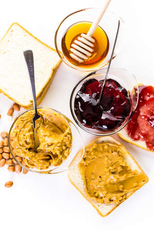 peanut butter and jelly sandwich: Homemade peanut butter and jelly sandwich on white bread.
