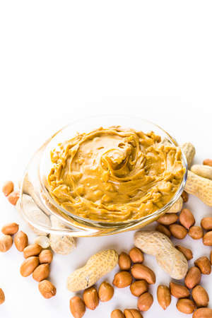 Extra chunky peanut butter on a white background.