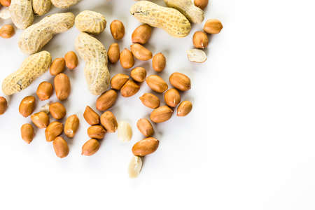 Peanuts peeled and in shells on a white background. Banco de Imagens