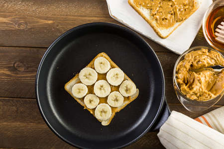 Homemade peanut butter and banana  sandwich on white bread.