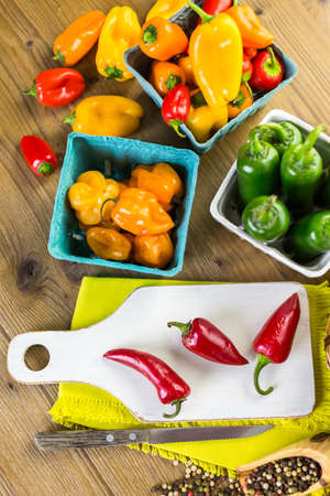 piperaceae: Variety of fresh organic peppers on the table.
