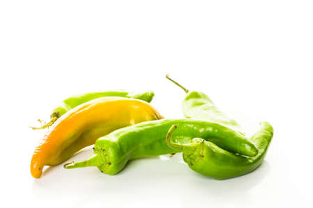 Mild chili peppers on a white background.
