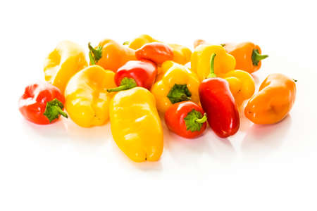 piperaceae: Sweet mini peppers on a white background.