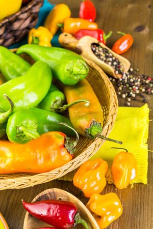 organic peppers: Variety of fresh organic peppers on the table.