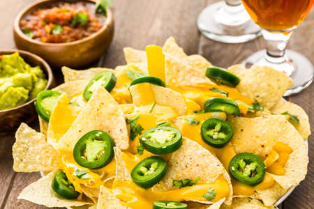 nachos: Vegetarian nachos with tortilla chips and fresh jalapeno peppers.
