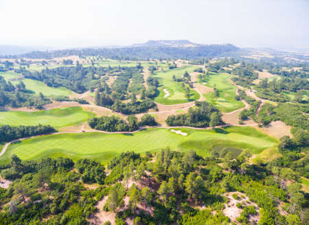daniels: Aerial view of golf course surraunded by natural park.