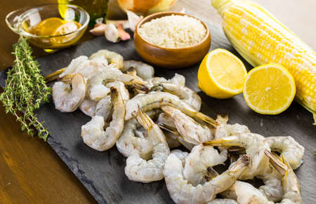 Raw ingredient for preparing corn risotto with roasted shrimp. Archivio Fotografico