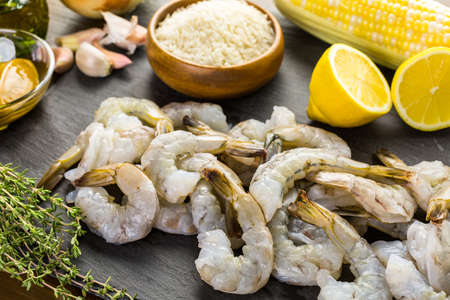Raw ingredient for preparing corn risotto with roasted shrimp. Stock Photo