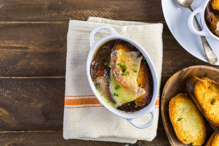 onion: Homemade French onion soup with toasted baguette. Stock Photo