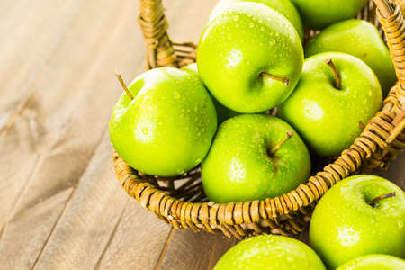 granny smith: Organic Granny Smith apples on the table.