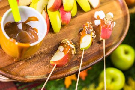 Autumn picnic with fresh caramel apple slices.