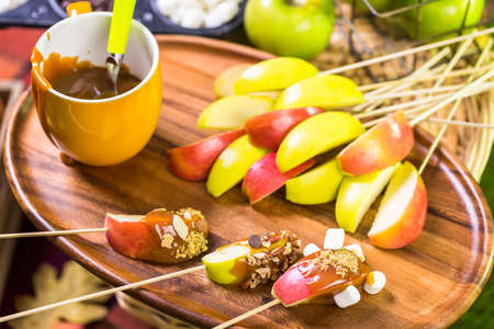 taffy apple: Autumn picnic with fresh caramel apple slices.