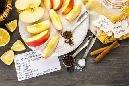 Ingredients for preparing homemade apple butter from organic apples.