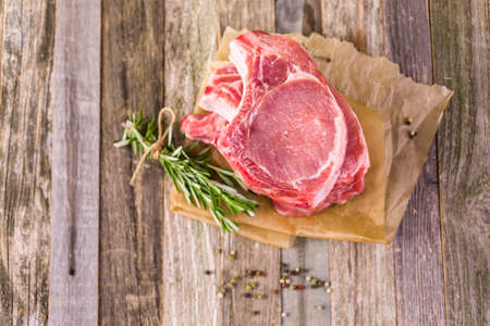 pork: Organic pork lion chops of thick cut with rosemary.
