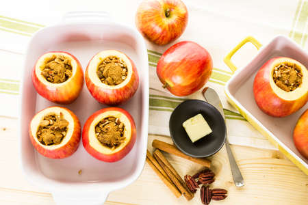 pecans: Ready to be baked organic apples with pecans and raisins. Stock Photo