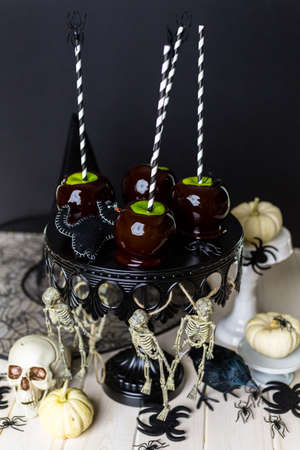 taffy apple: Homemade candy apples for Halloween party on the table.