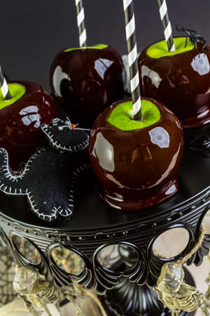 taffy: Homemade candy apples for Halloween party on the table.