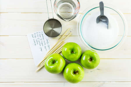 Ingredients for preparing homemade black candy apples.