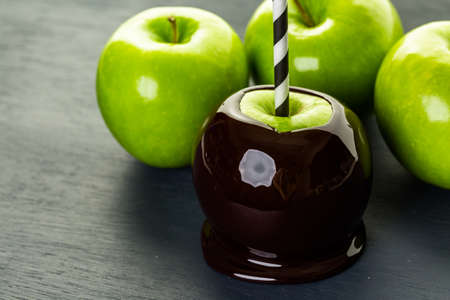 taffy apple: Homemade candy apples on black backgeound. Stock Photo