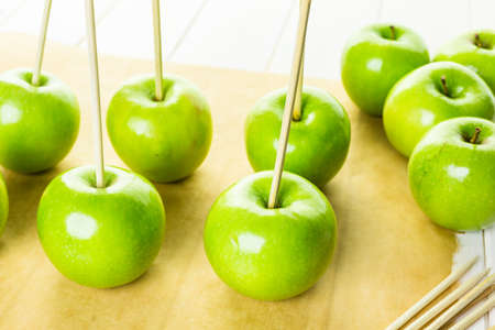 taffy apple: Ingredients for preparing homemade black candy apples.