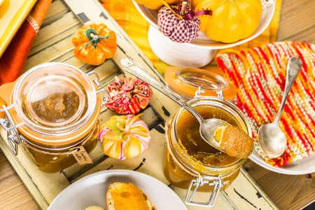 Homemade pumpkin butter made with organic pumpkins. Imagens - 45971343