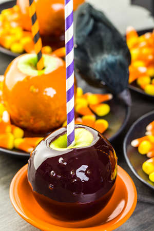 taffy apple: Handmade orange candy apples for Halloween.
