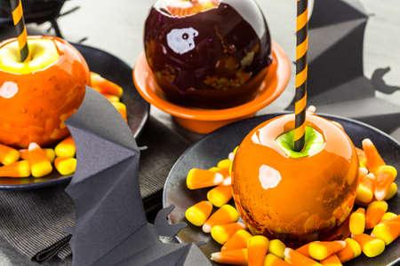 Handmade orange candy apples for Halloween.