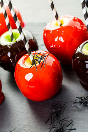 taffy apple: Handmade red candy apples for Halloween.