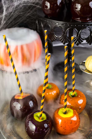 webb: Table with colored candy apples for Halloween party. Stock Photo