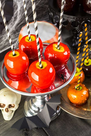 stock photo table with colored candy apples for halloween party - Christmas Candy Apples