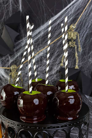 taffy: Table with colored candy apples for Halloween party. Stock Photo