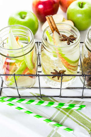 infused: Infused apple water with cinnamon and anise. Stock Photo