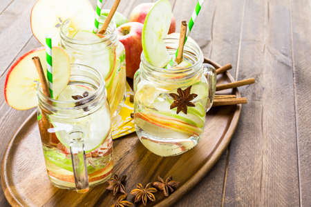 Infused apple water with cinnamon and anise. Reklamní fotografie