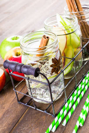 Infused apple water with cinnamon and anise. Stock Photo