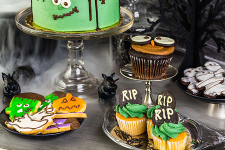 chocolate cakes: Food table arrangement prepared for Halloween party.