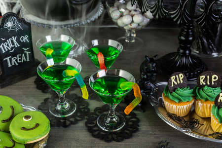 patty cake: Food table arrangement prepared for Halloween party.