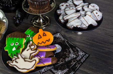 baked treat: Food table arrangement prepared for Halloween party.