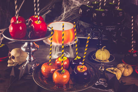 taffy apple: Table with colored candy apples for Halloween party. Stock Photo