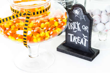 candy: Candy corn in candy jar for Halloween treats.
