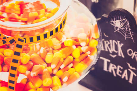 candy corn: Candy corn in candy jar for Halloween treats.