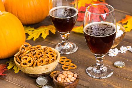 ipa: Craft pumpkin beer in beer glasses with salty pretzels and popcorn.
