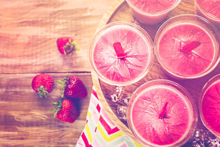 plastic made: Homemade strawberry ice made in plastic cups. Stock Photo