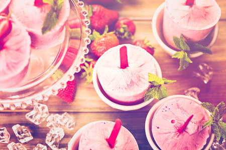 homemade: Homemade strawberry ice made in plastic cups. Stock Photo