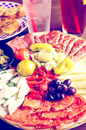 ethnic mix: Appetizers plate with antipasto in Italian restaurant. Stock Photo