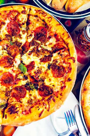 combo: Fresh combo pizza in Italian restaurant.