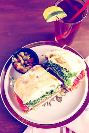 ciabatta: Italian sub sandwich with arugula on ciabatta bread.